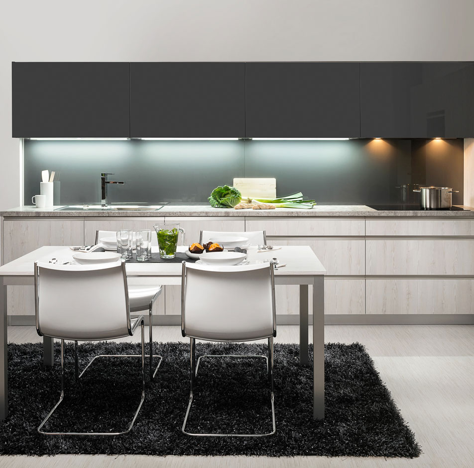 Dark Gray Handleless Kitchen With Table
